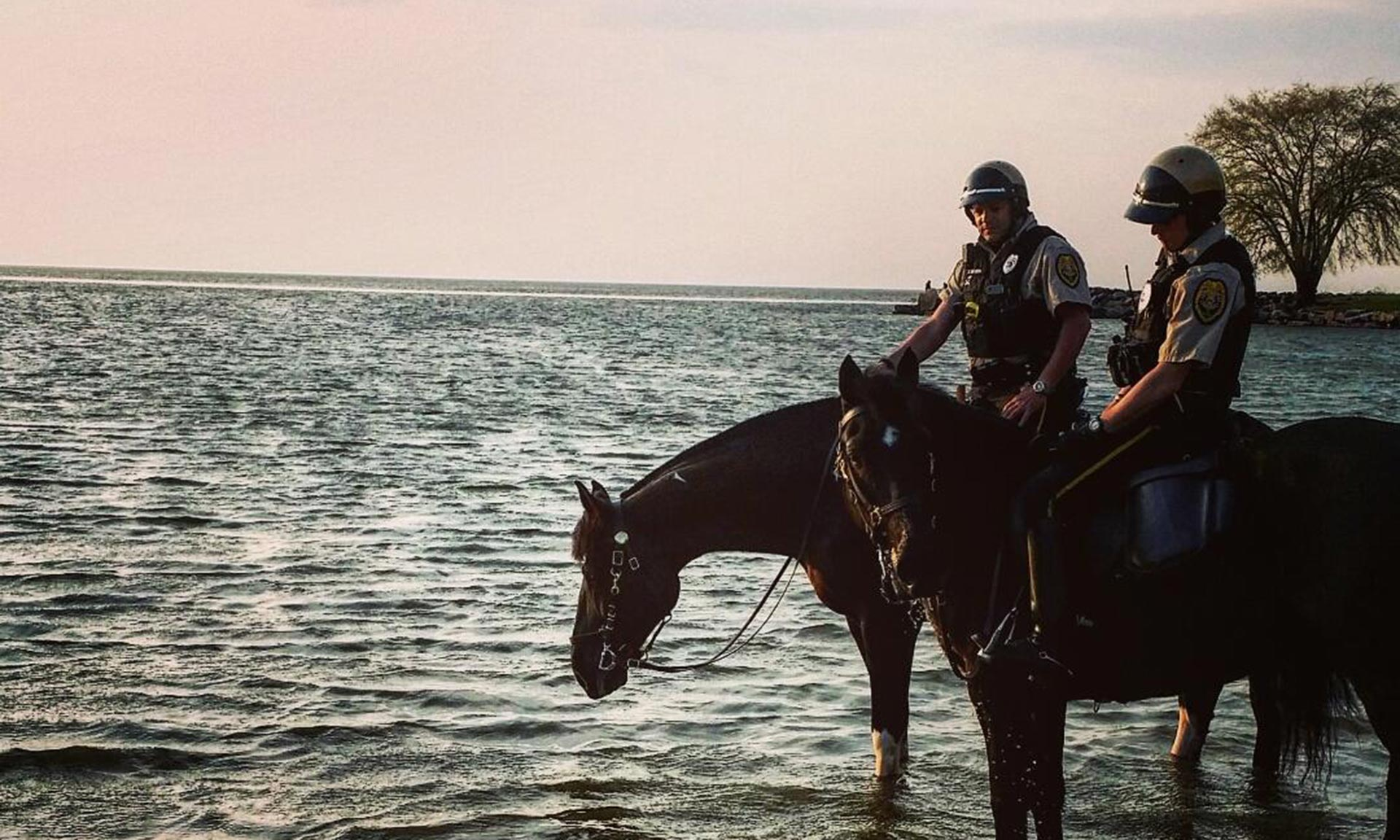 Two Mounted Rangers on the coast at sunset