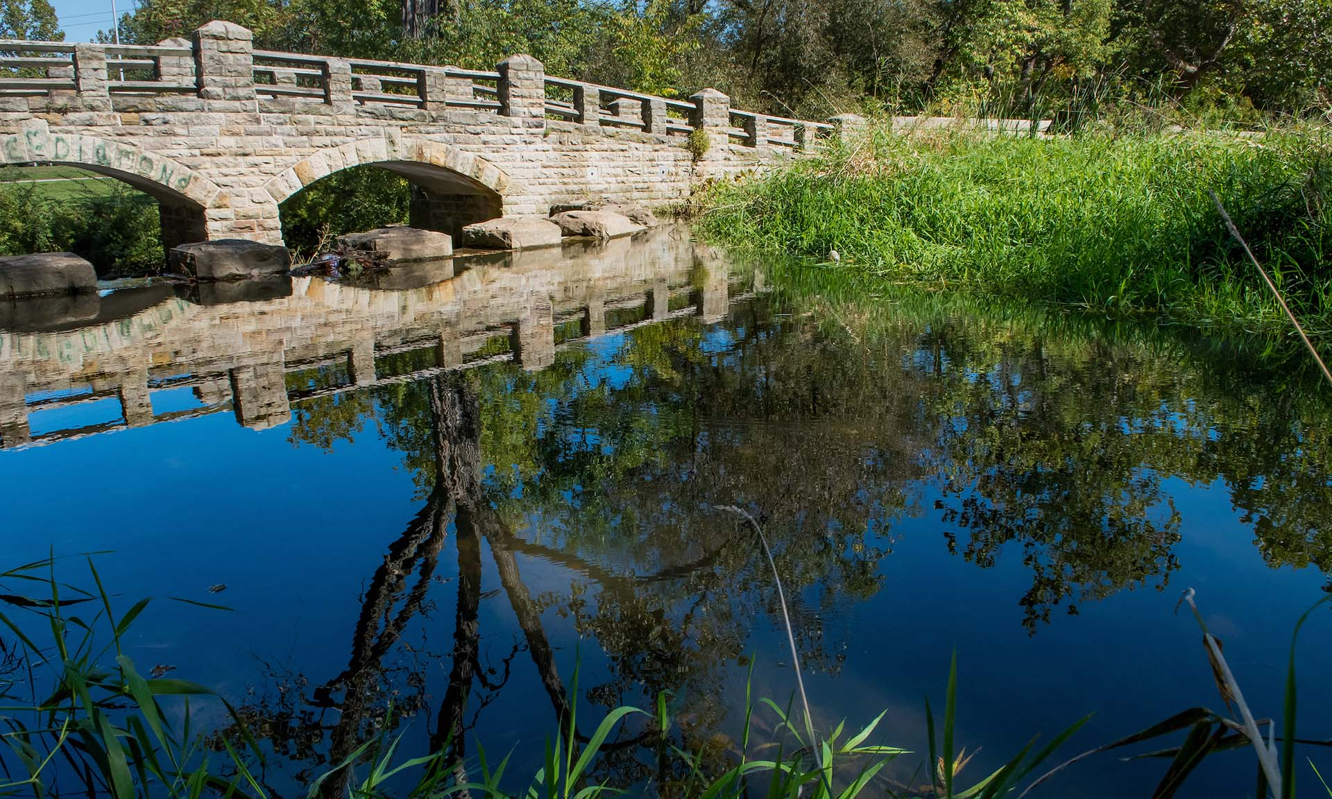 Bridge Reflecting on Wolf Creek at Garfield Park Reservation