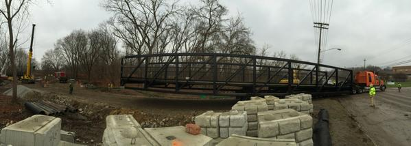CLEVELAND METROPARKS INSTALLS  150 FT. STEEL PEDESTRIAN BRIDGE SPANNING MILL CREEK