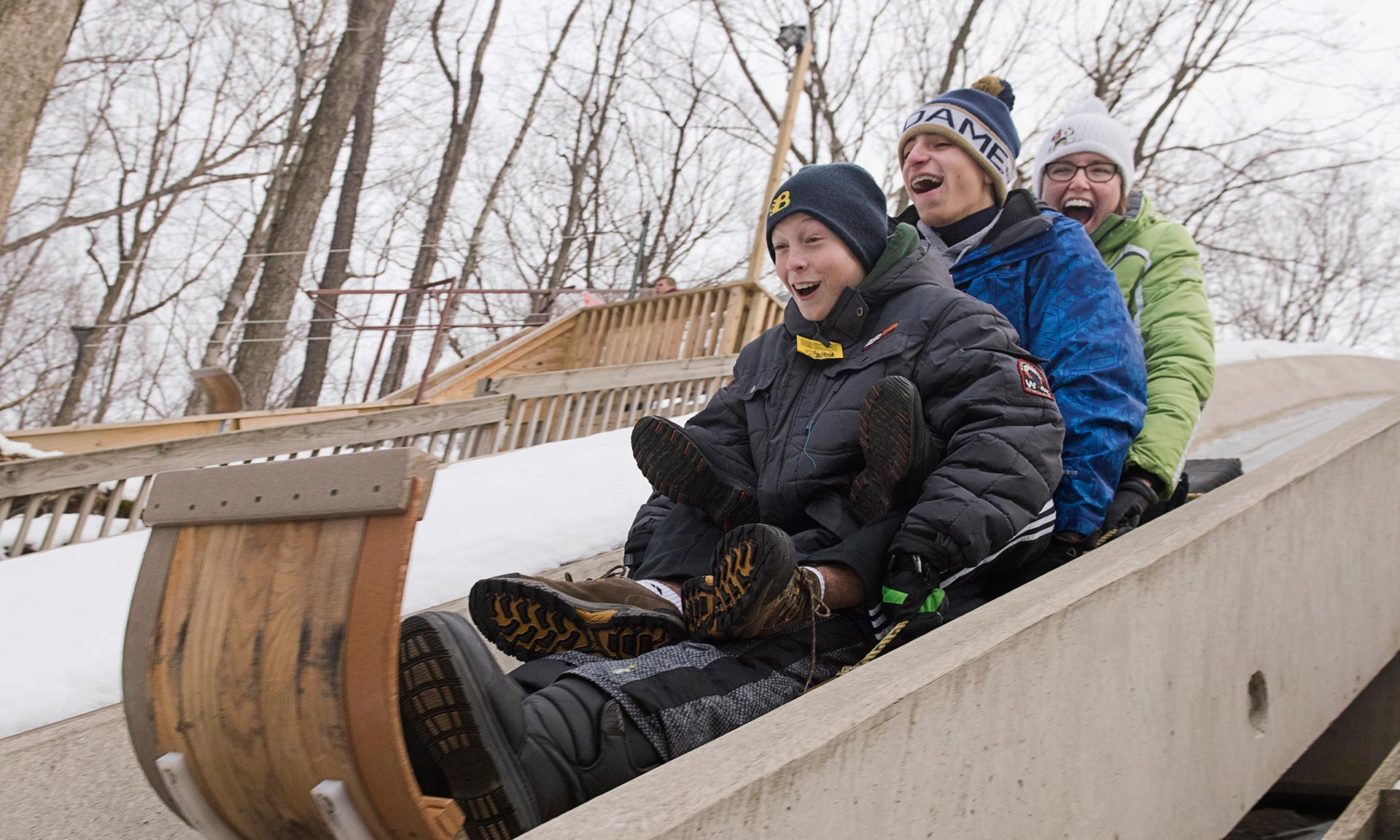 Kids start their ride down toboggan chutes during winter