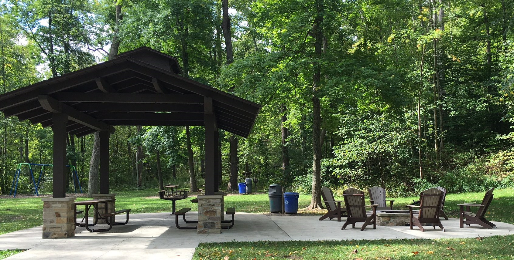 A photo of Johnson's Picnic area, featuring a covered shelter and concrete patio area.
